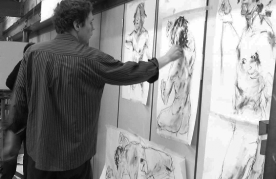 Black and white image of HSoA tutor working on art